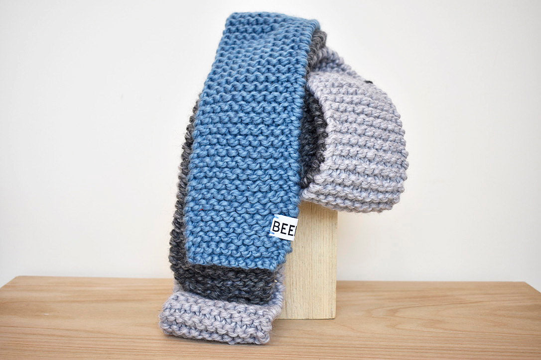 Long hand knit color block scarf in grey/blue