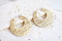Oversized gold disc hoop earring