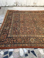 7' x 11' antique Persian Mahal in rust (#1167)