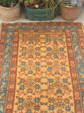4' x 5'9 antique Persian Malayer with saffron ground