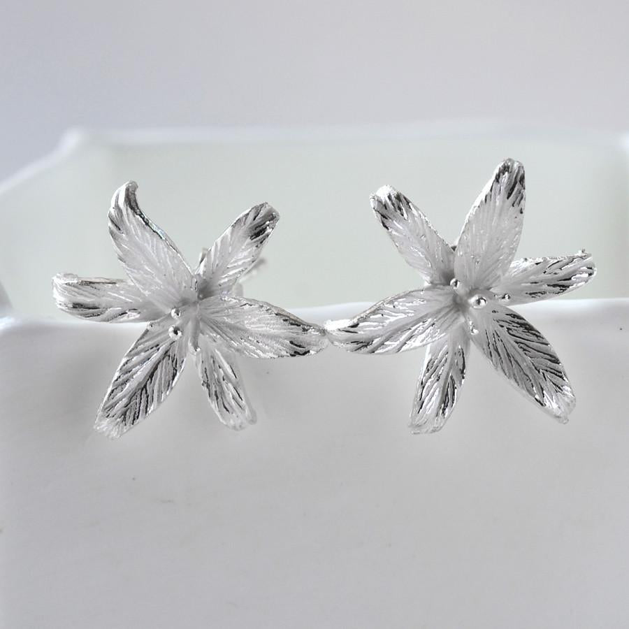 Silver Lily Flower Star Stud Earrings by Martha Jackson