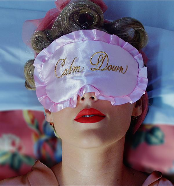 "image of Taylor Swift wearing the pink sleep mask with ""Calm Down"" Embroidery"