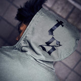 Close up of the hood of a person wearing the OLIVE TOUR JACKET WITH SNAKE DESIGN