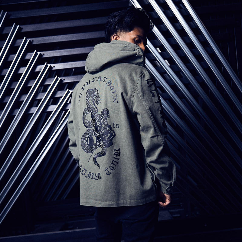 Person wearing the OLIVE TOUR JACKET WITH SNAKE DESIGN