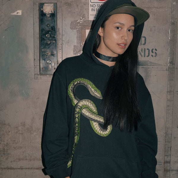 Person wearing the BLACK HOODIE WITH GREEN SNAKE DESIGN