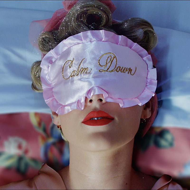 "Taylor Swift wearing the Pink Sleep Mask with ""Calm Down"" Embroidery"