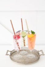 Reusable straws by Ever Ecositting in drinks on a tray.