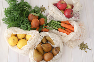 Cotton fruit and vegetable bags filled with various fresh produce