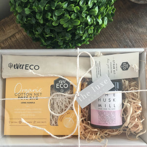 Gift pack containing cacao tea and eco products by The Husk Mill and Ever Eco