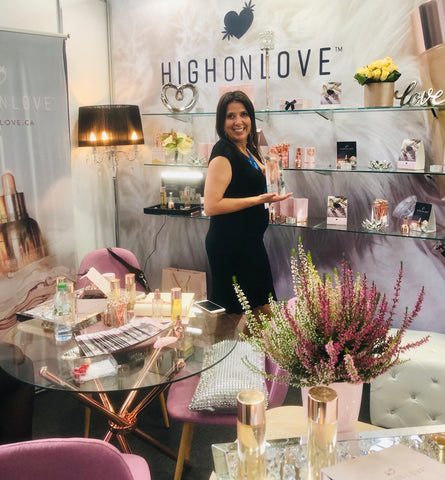 angela mustone of high on love at her expo booth