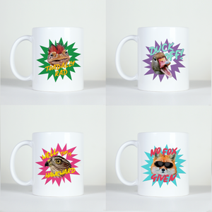 four coffee mugs with funny comic style images of animals