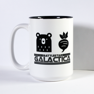 black icons of a bear a beet and logo of battlestar galactica on a large mug with black interior