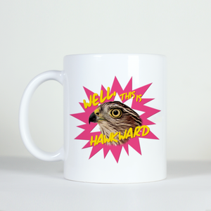 animal pun mug saying well that was hawk-ward with an image of a hawk with pink background