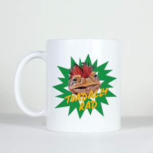 image of green toad with mo-hawk on white mug saying totally rad