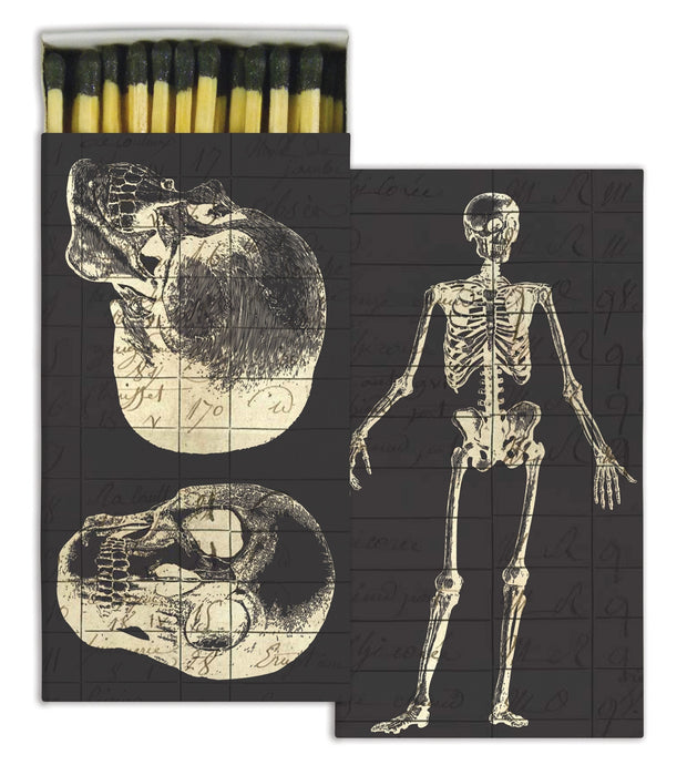 Box of matches with vintage illustration of skeleton on one side and skull on the other, with faint old writing