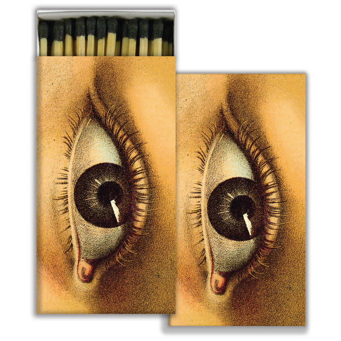 Box of matches with close-up of female eye illustration