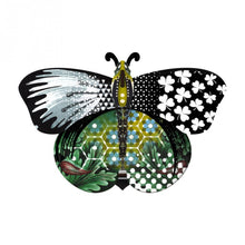 Aida butterfly wall cabinet with collage of patterns in green, black, and blue