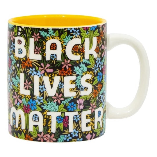 Black Lives Matter mug with colorful wildflowers pattern, yellow color inside mug.