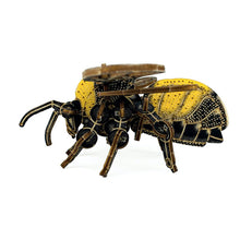 side view of 3d bumblebee model, screen printed with yellow and black details