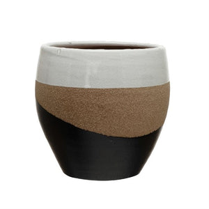 Multi-colored pot, white top, sand middle, and wavy black base