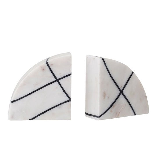 Pair of white bookends with black geometric lines on white background