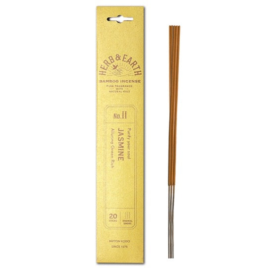 mustard color package with gold text and three incense sticks on right.