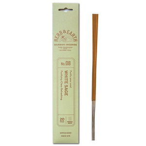 mint color package with gold text and three incense sticks on right.