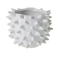 Glossy white ceramic pot with spikes