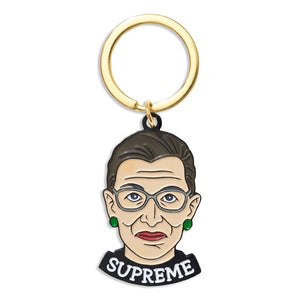Ruth Bader Ginsburg with the text Supreme written around collar.  Brass key ring
