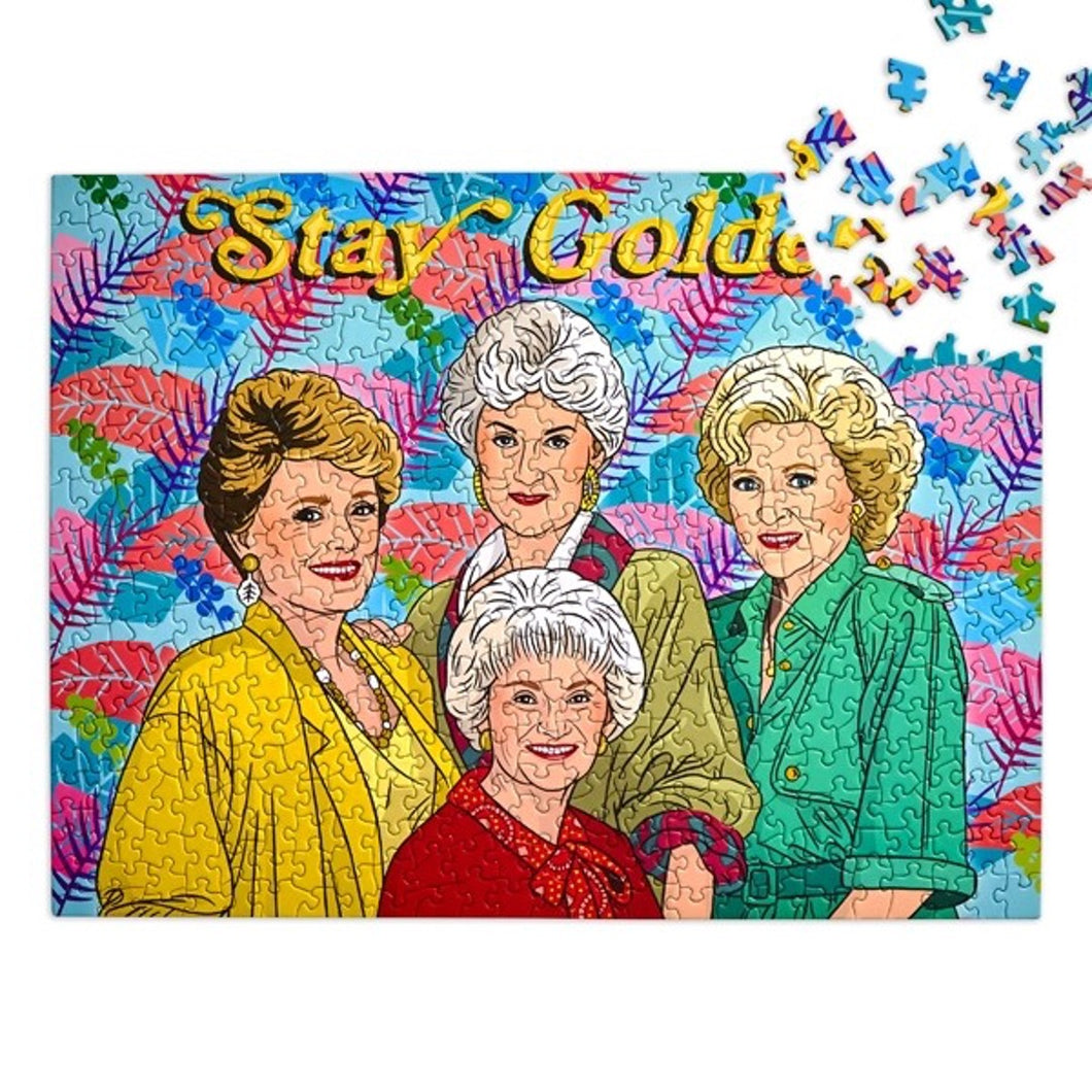 Golden Girls puzzle, multi-color palm leaves in background with text Stay Golden