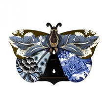 Tosca butterfly wall cabinet wings open with 2 holes for hanging, with a collage of blue and black patterns