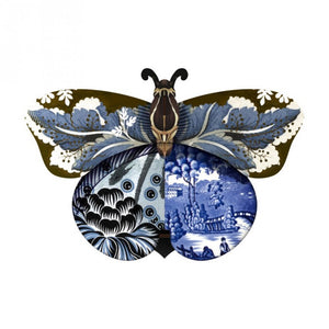 Tosca butterfly wall cabinet with a collage of blue and black patterns