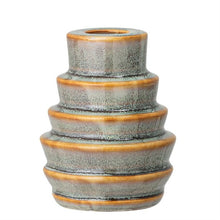 Round stoneware candle holder, blue fades to green and brown colors in the details.