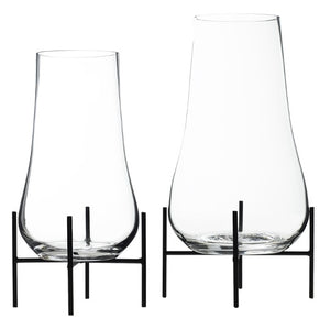 Set of glass terrariums on black metal stand