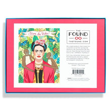 Back box of 500 piece jigsaw puzzle, Frida Kahlo in jungle with two monkeys on each side of her shoulder with Viva La Vida banner on top