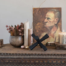 Collection of  home decor items - bowl with dried flowers, books, wooden jack, lit candle with canvas print of old man.