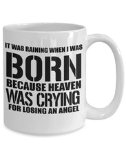 Age Quote - Coffee Mug - It was raining when I was born Heaven was crying for losing an angel Coffee Mug Gearbubble