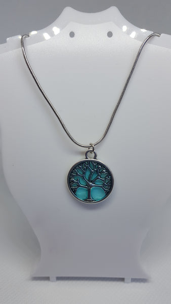 "Tree of life pendant on an 18"" silver coated chain"