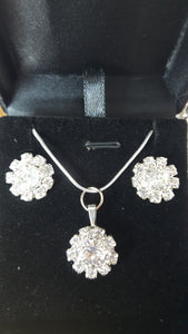 "18"" silver coated necklace chain with a silver pendant and matching earrings."