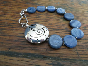 blue kyanite gemstone coin bracelet with a large silver focal bead