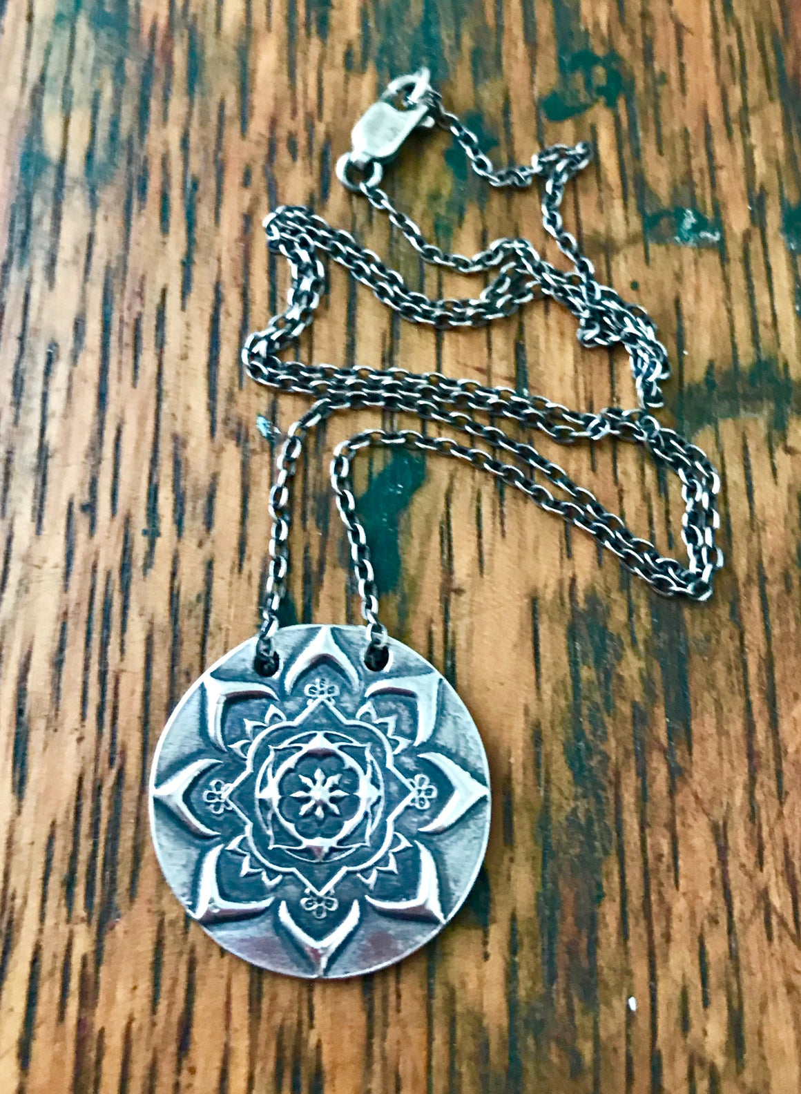 large circular oxidized silver mandala pendant on silver chain