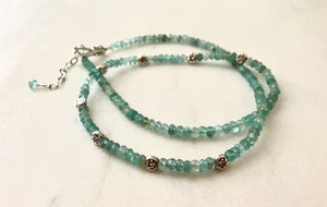 Faceted blue quartz rondelle gemstone necklace with small sterling silver flower beads