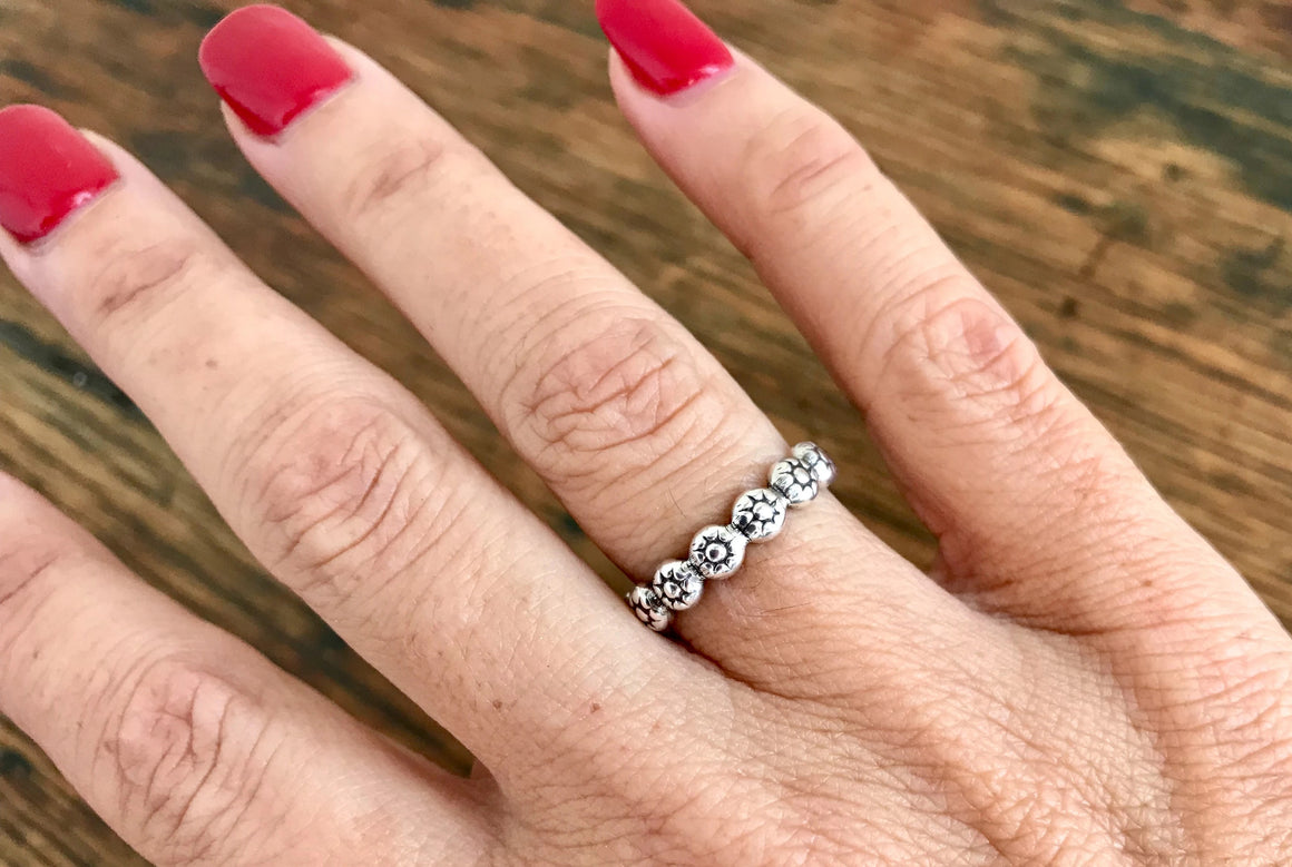 Thick Sterling Silver Band of Flowers Ring