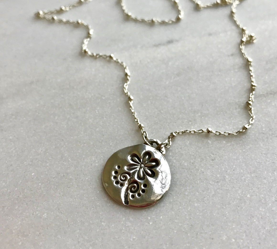 Circular Pendant Stamped with a Flower on Sterling Silver Satellite Chain