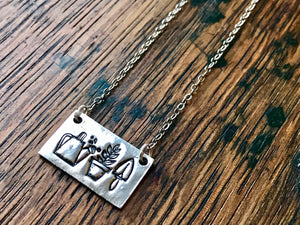 Small Silver Gardener's Necklace with Watering Can Plant and Spade