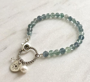 blue and green fluorite gemstone bracelet with silver, pearl and quartz charms
