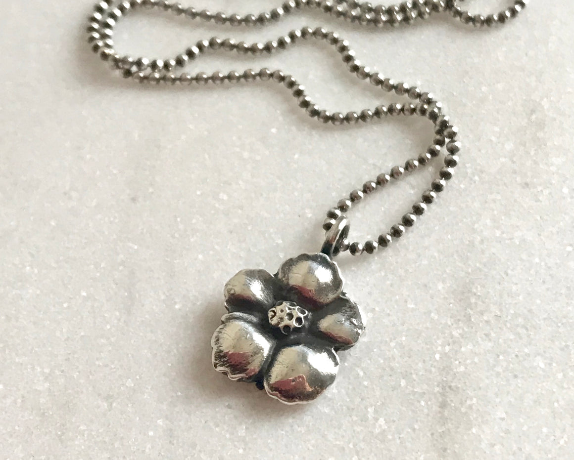 small antiqued silver flower pendant on a silver ball chain
