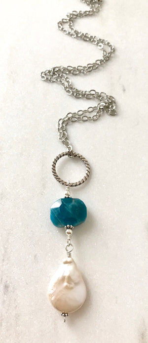 long silver chain necklace with a twisted silver ring, blue apatite gemstone and large white pearl teardrop pendant