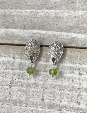 small silver leaf teardrop shaped post earrings with green peridot drops