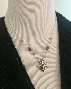 diamond shaped silver thistle pendant with green peridot and purple amethyst gemstone beads